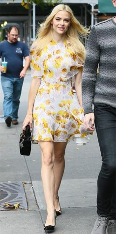 King was snapped headed to the beauty brand Nourage event in a flirty yellow floral-print chiffon Giambattista Valli dress that she accessorized with a black mini ladylike Dior handbag and black Dior pumps.