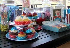 CoOper's BiG ToP | CatchMyParty.com cupcake stand= 2 colorful plastic plates with a crystal candle stick