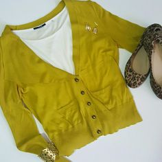 Moth by Anthropologie mustard cardigan Great with jeans or a skirt. No stains or tears. Buttons are bronze colored. Anthropologie Sweaters Cardigans