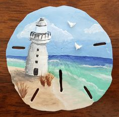 Hand Painted Lighthouse Sand Dollar with Doves by TidalWaveofColor on Etsy Seashell Ornaments, Seashell Art, Seashell Crafts, Starfish, Shell Painting, Stone Painting, Rock Painting, Shells And Sand, Sea Shells