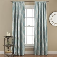 Save energy and dress up your home decor with this pair of blackout curtains by Lush Decor. With a stylish paisley pattern, these curtains block out sunlight to improve insulation in your home.
