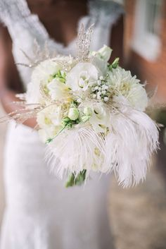White bridal bouquet with feathers | Sarah Hooker Photography | see more on: http://burnettsboards.com/2015/09/art-deco-wedding-asheville/