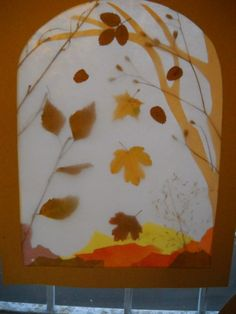 Fun to make with kids: a transparency using autum leaves or spring flowers!