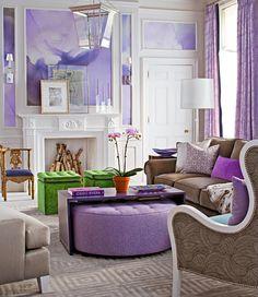 Round ottoman tucked beneath high gloss purple coffee table! Designer Eileen Kathryn Boyd