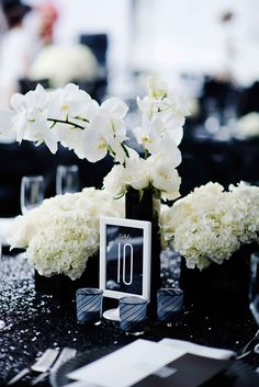 Low, Orchid & Hydrangea Centerpieces on Sequined Linen | Photography: Kortnee Kate. Read More: http://www.insideweddings.com/weddings/black-and-white-modern-wedding-with-unique-details-in-cincinnati/698/