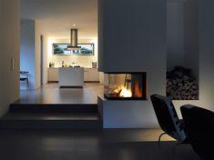 Open fireplace, modern kitchen, dark floors