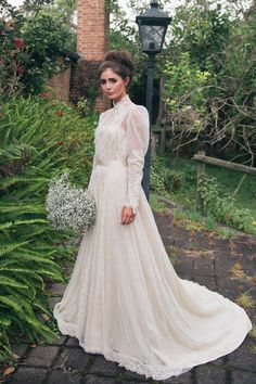 Gorgeous and modest vintage wedding dress - love the lace collar and the intricate sleeves <3