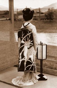 "A haunting glimpse of a Geisha staring out at the river ""The Floating World"""