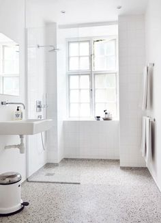 Bright and clean bathroom with large windows. Less is more as you say.