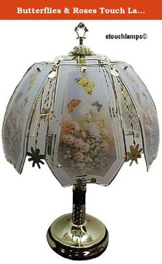 """Butterflies & Roses Touch Lamp with Polished Brass Base. Standing 23"""" tall the base of this lamp has a Polished Brass finish. Touching the base anywhere turns the lamp on and off and controls the 3 power settings. What makes this lamp so special is the shade. In a brass metal framework are 6 panels of glass. Each panel has a picture of butterflies flying above pink roses. The diameter of the shade is 14"""" so this is a nice size lamp. This lamp will enhance many different decors and makes a..."""