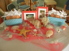 Beach Baby Shower - Entry Table - Framed Baby Pictures of Mom & Dad - Mermaid Cookies - Shells, Glass Bubbles, & Tulle
