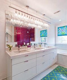 Don't skimp on bathroom accessories. Add a crystal light fixture for decoration and functionality.