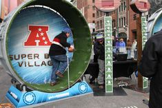Other activities at Super Bowl Village included the Super Bowl Host Committee and Global Inheritance's 100-Yard Hamster Wheel Dash, which......