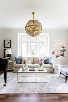 A few streamlined pieces go a long way in striking a modern-traditional balance, says McGee. In this living room, sculptural task lamps and simple furniture offset the traditional leanings of the floral and paisley accessories. The result is layered and surprising rather than one-note.