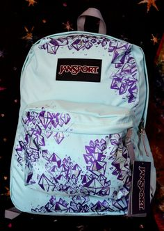 Hand painted crystal Jansport backpack by EmilyDwan.com. Available on Etsy for $125  https://www.etsy.com/listing/156390066/hand-painted-crystal-jansport-backpack