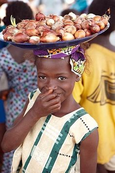 beautiful young girl with onions to sell - Sierra Leone