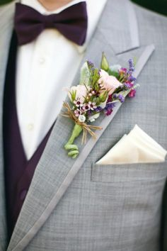 Soft pink and purple against a gray suit. #pinkroses #boutonniere #weddinginspiration Designed by: Petals and Leaves in Columbus, OH