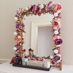 Simple, Fast DIY Wall Art Project! Hot glue faux flowers around the border of a wall mirror, picture frame, etc.