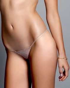 SHEER SEXY MICRO THONG PANTY @ Love Haus LH141002-NUDE <br> Stretch illusion fishnet is the perfect fabric for our barely there micro thong. The elastic has wonderful stretch so that it lays on you comfortably while just resting at the right spot in the center back with a tiny o-ring detail.