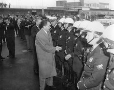 Vice-President Richard Nixon thanks Wilmington, Delaware traffic police.    1960.