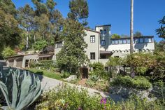 Singer Sheryl Crow's private compound sits on more than 10 acres of land perched above the heart of Hollywood. The main home is a Spanish Revival that has 4 bedrooms and 3.5 baths that have been remodeled and restored.