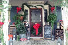 Every inch of this porch is decked with Christmas cheer, from its abundance of garland to smaller details like a vintage sled. A chalkboard sign displays seasonal greetings for all to see. See more at Cottage in the Oaks.