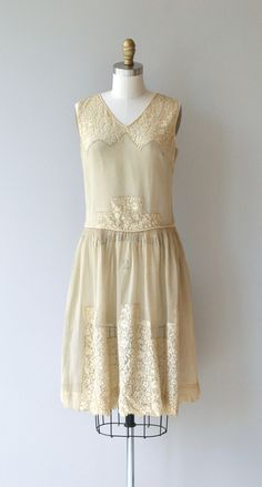 Antique 1920s cream silk dress with lace inserts and gathered drop waist.  --- M E A S U R E M E N T S ---  fits like: xs bust: 32 waist: up to 26 hip: up to 38 length: 39 brand/maker: n/a condition: no flaws, but fabric is a little dry and should be worn gently  ✩ layaway is available for this item  To ensure a good fit, please read the sizing guide: http://www.etsy.com/shop/DearGolden/policy  ✩ more vintage dresses ✩ http://www.etsy.com/shop/DearGolden?section_id=5986725  ✩ visit the shop…