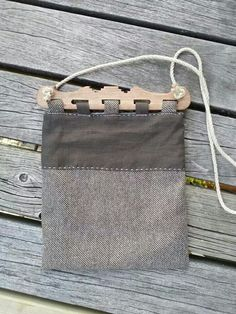 Viking style bag with wooden handles inspired by the Hedeby finds. I like the bag to frame attachment that this style uses, but I would probably tablet-weave the strap.