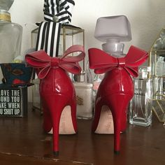 Red Patent Heels with Bow Worn Twice. Size 7.5 I keep the toes stuffed so the patent toe keeps perfect shape. These red heels speak for themselves❤️ Comes with the Box! Neiman Marcus Shoes Heels