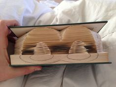 This is a good tutorial on book folding. Be sure to read it all before you begin folding. This tutorial has pictures of numbers, but you can use the same techniques to make letters (what I did).