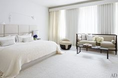 White master bedroom in a New York City townhouse