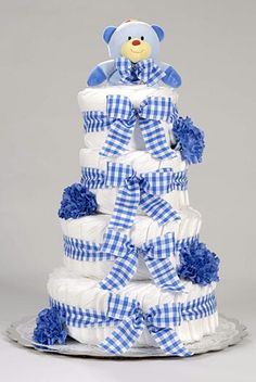 #Simple but #beautiful #diaper #cake for #little #boy #diapers #striped #white and #blue #ribbon #blue #flowers and a #blue #teddy #bear