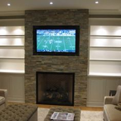 fireplace remodels | Television mounted above Fireplace | House remodel