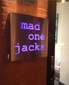 LED Internally Illuminated Sign With Stencil Cut Face for mad one jacks in Hoboken, NJ