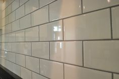 Black grout - we're going to do this in the kitchen | kitchen ... Grey Subway Tiles, White Subway Tile Backsplash, Subway Tile Kitchen, Kitchen Backsplash, Backsplash Ideas, Splashback Tiles, Black Kitchens, Cool Kitchens, Kitchen Redo