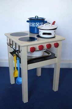 It's a simple version of a play kitchen that includes only a stove and oven, so it's compact and easy to make.    An IKEA hacker from Germany created this simple stove for her kids. It requires only an ODDVAR stool, a few hooks and knobs. With some paint, she created burners and an oven that look clean and simple but, we expect, could produce some serious imaginary cooking.
