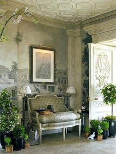 French or Italian old world foyer with topiary, sofa