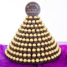 Ferrero rocher tower. Hold 242 Ferrero sweets! A great talking point for your big day :0)