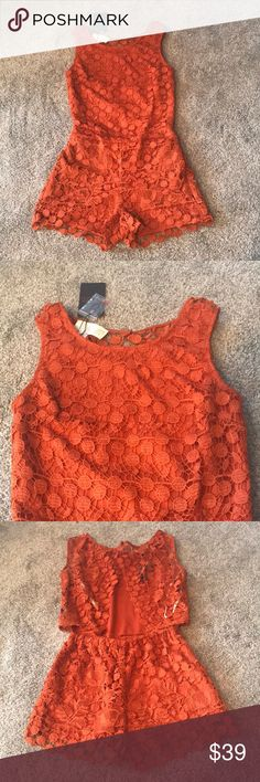 NWT Lace Romper Gorgeous romper! NWT and in perfect condition. Beautiful lace and super cute open back detail in back. 100% polyester. Burnt orange color. Pants Jumpsuits & Rompers