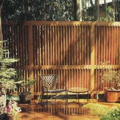 Closely space redwood slats give the appearance of plantation blinds or shutters.