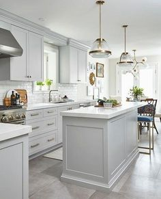 White kitchen is never a wrong idea. The elegance of white kitchens can always provide . Elegant White Kitchen Design Ideas for Modern Home Grey Kitchen Cabinets, Kitchen Cabinet Design, Kitchen Flooring, Interior Design Kitchen, Kitchen Backsplash, Kitchen With White Countertops, Kitchen Hardware, Grey Kitchen Tiles, Grey Cupboards