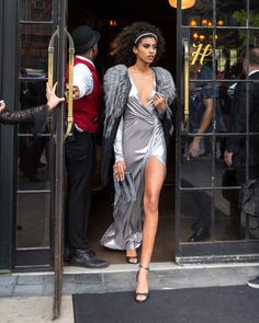 Imaan Hammam makes a striking exit in her custom DVF wrap dress.