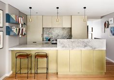Its all about Symmetry and granite in this kitchen design.