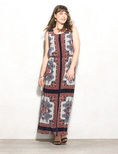 Not your average printed maxi dress. This one's got allover pleats to take it to the next level. Wear this to dinner with your favorite dangly earrings and throw a lightweight shrug over top. Imported.