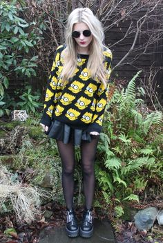 Edgy look Bart sweater black tights retro sunglasses skater skirt and boots