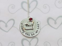 Hey, I found this really awesome Etsy listing at https://www.etsy.com/listing/111940641/i-carry-you-in-my-heart-necklace-hand