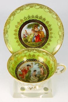 Royal Vienna demitasse cup and saucer, each having a figural scene over a bright lime green ground, gold gilt.