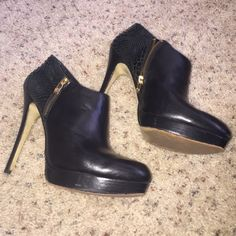 sale today Trendy Michael Kors booties LIMITED TIME PRICE REDUCTION Size 10. 4-41/2 inch heel.faux snake skin design on heel of foot, black leather top of foot. Zippers on both side of shoe but only inside really is used to put the shoe on. Bring on the offers, cause these babies are hot!! MICHAEL Michael Kors Shoes Ankle Boots & Booties