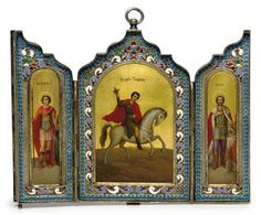 A Silver-Gilt and Cloisonné Enamel Triptych Icon -   Cyrillic maker's mark 'YeR', Moscow, 1899-1908 -   Rectangular with shaped upper section, the outer cover engraved with roundels surmounted by crosses, the hinged doors opening to reveal a central panel depicting St Trifon, flanked by St George and St Alexander Nevskii, within a border enamelled with vari-coloured stylized foliage and turquoise pellets, marked on lower edge and suspension loop  6½ in. (16.5 cm.) wide, extended