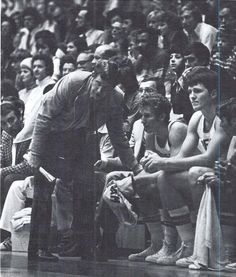 Oregon basketball coach Dick Harter speaks to his bench players 1976. From the 1976 Oregana (University of Oregon yearbook). www.CampusAttic.com